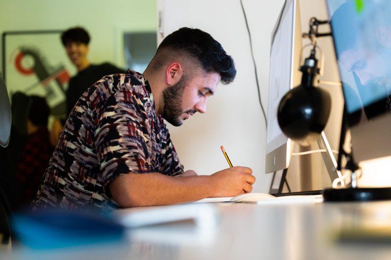 Designer working on web design brief